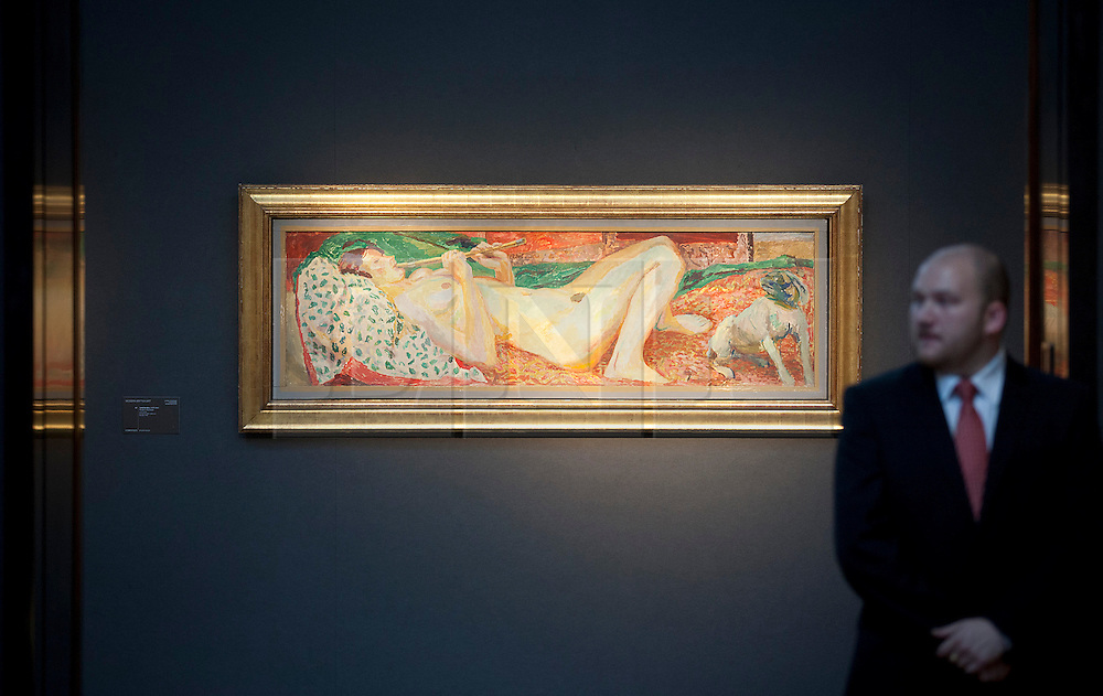 © Licensed to London News Pictures. 10/12/2012. London, UK. A Christie's security guard keeps watch over Duncan Grant's 'Nude with a Flute' (Circa 1914-15) (est. GB£100,000-150,000) at a press view ahead of an evening sale at the auction house's King Street premises in London today (10/12/12).  The evening auction, entitled 'Rule Britannia', and featuring over 185 lots by Britain's most influential modern artists, takes place on Wednesday the 13th Of December. Photo credit: Matt Cetti-Roberts/LNP