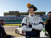 NASCAR driver Brad Keselowski watches Sprint Cup qualifying from pit road at Kansas Speedway in Kansas City, Kan., Friday, Oct. 16, 2015. Keselowski won the poll position with the fastest lap speed of 27.621 seconds. (AP Photo/Colin E. Braley)