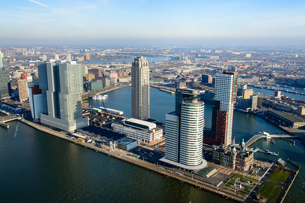 Nederland, Zuid-Holland, Rotterdam, 18-02-2015; Kop van Zuid met in de voorgrond rivier de Nieuwe Maas, achter de Wilhelminapier de Rijnhaven. Op de Wilhelminakade Hotel New York tussen de torens van Montevideo (rechts) en het World Port Center (Havenbedrijf Rotterdam).<br /> Verder o.a. De Rotterdam. Las Palmas en New Orleans. <br /> Newly developed cultural center Kop van Zuid, urban renewal and modern architecture, high rise in a former harbour area<br /> luchtfoto (toeslag op standard tarieven);<br /> aerial photo (additional fee required);<br /> copyright foto/photo Siebe Swar