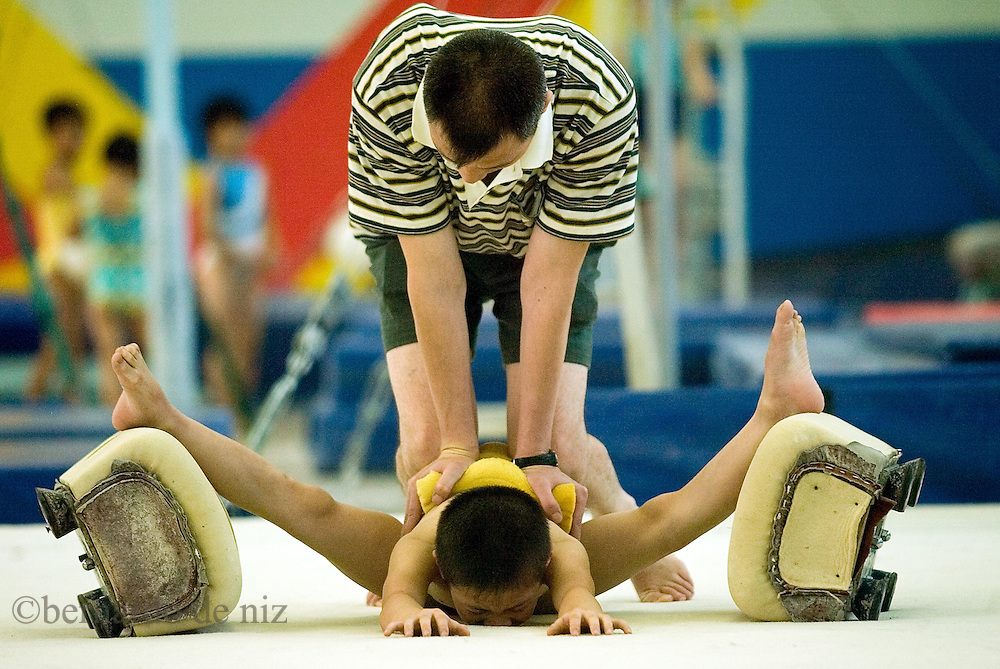 Little Chinese boys are training  gymnastic at the , Beijing Shichahai Sports School. Established in 1958 is located in the west bank of Shichahai, also one of the main center for training young sports talents in Beijing, and rated as a key secondary technical school with a primary and junior section, base of national high level athletic talents, training center of national high level badminton talents. We provide sports training as Wushu, Ping-Pong, Badminton, Weightlifting, Gymnastics, Volleyball, Tennis, Boxing, Free Combat, and Taekwondo.Photos: Bernardo De Niz