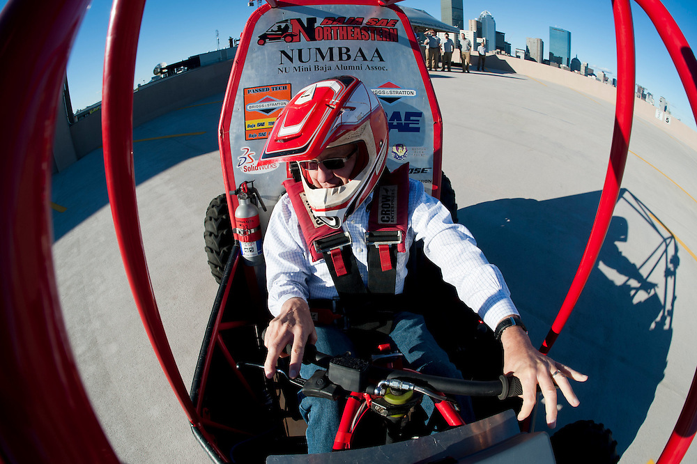 September 23, 2013 - Stephen Director, Provost and Senior Vice President for Academic Affairs, test drives the Baja SAE buggy during a demonstration on the roof of the Columbus Parking Garage.