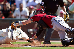 May 30, 2010; San Francisco, CA, USA;  Arizona Diamondbacks catcher Chris Snyder (19) tags out San Francisco Giants third baseman Ryan Rohlinger (29) at home plate during the seventh inning at AT&T Park.