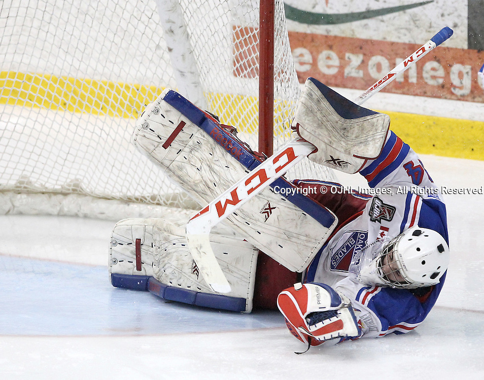 OAKVILLE, ON  - MAR 3,  2017: Ontario Junior Hockey League, playoff game between the Oakville Blades and the North York Rangers. Brendan McGlynn #34 of the Oakville Blades makes the save during the third period.<br /> (Photo by Tim Bates / OJHL Images)