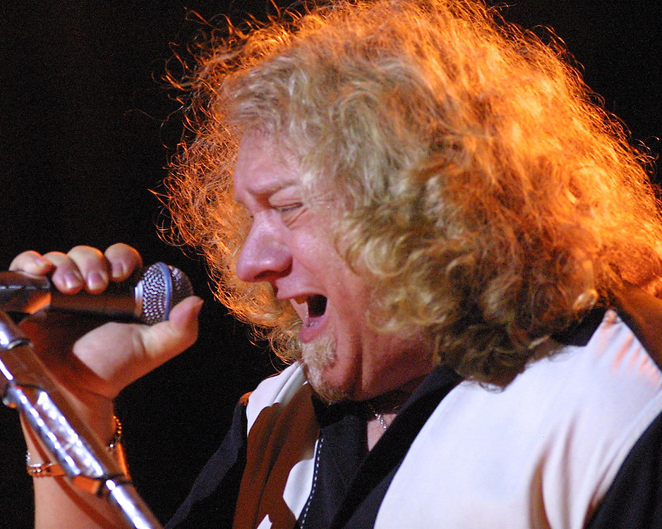Lou Gramm and Foreigner on stage at Chatautqua Instiution 8/2003 photo by Mark L. Anderson