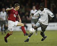 Photo: Aidan Ellis.<br /> York City v Bristol City. The FA Cup. 11/11/2006.<br /> York's Anthony Lloyd (L) battles with Bristol's Enoch Showunmi