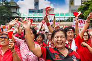 19 MAY 2013 - BANGKOK, THAILAND:    Red Shirts cheer during a Red Shirt rally in Ratchaprasong Intersection honoring Red Shirts killed by the Thai army in 2010. More than 85 people, most of them civilians, were killed during the Thai army crackdown against the Red Shirt protesters in April and May 2010. The Red Shirts were protesting against the government of Abhisit Vejjajiva, a member of the opposition who became Prime Minister after Thai courts ruled the Red Shirt supported government was unconstitutional. The protests rocked Bangkok from March 2010 until May 19, 2010 when Thai troops swept through the protest areas arresting hundreds.      PHOTO BY JACK KURTZ