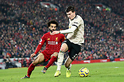 Manchester United defender Victor Lindelof (2) gets chased down by Liverpool forward Mohamed Salah (11) during the Premier League match between Liverpool and Manchester United at Anfield, Liverpool, England on 19 January 2020.