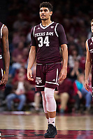 FAYETTEVILLE, AR - FEBRUARY 17:  Tyler Davis #34 of the Texas A&M Aggies standing at mid court during a game against the Arkansas Razorbacks at Bud Walton Arena on February 17, 2018 in Fayetteville, Arkansas.  The Razorbacks defeated the Aggies 94-75.  (Photo by Wesley Hitt/Getty Images) *** Local Caption *** Tyler Davis