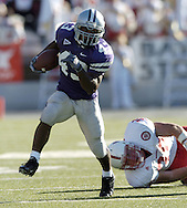 Running back Darren Sproles (43) of Kansas State, runs past Nebraska linebacker Barrett Ruud (38) for a 30-yard gain, down to the Husker nine yard line, during the fourth quarter at KSU Stadium in Manhattan, Kansas.  K-State beat Nebraska 45-21, Oct. 23, 2004.