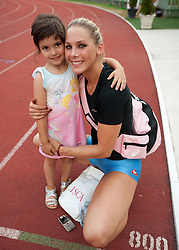Snezana Rodic with her daughter Lara after she won during the triple jump at Slovenian National Championships in athletics 2010, on July 17, 2010 in Velenje, Slovenia. (Photo by Vid Ponikvar / Sportida)
