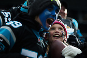 January 17, 2016: Carolina Panthers vs Seattle Seahawks. Carolina Panthers fan smiles after being given a game ball