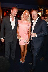 Left to right, SEBASTIAN & CLARE VAN DAM  and ROB DIVER managing director for TAG Heuer UK at the launch of TAG Heuer's new Aquaracer in the presence of long term friend of the brand Bo Derek held at Tramp, Jermyn Street, London on 8th October 2013.