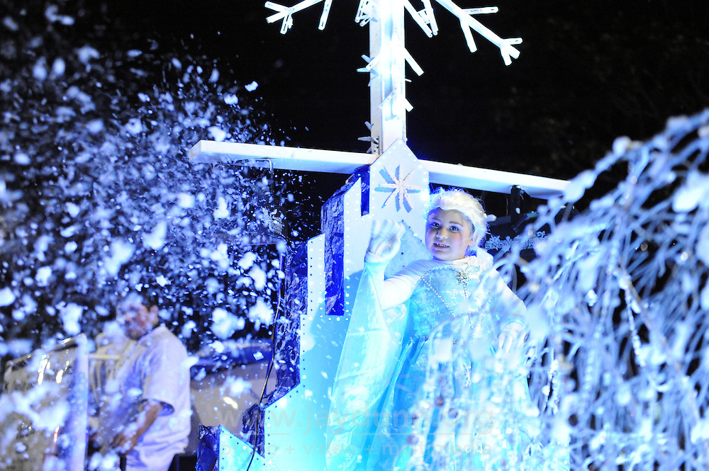 A snow queen waves to the crowds during the parade on Sunday. Thousands of Salinas residents turned out to experience the magic of the 14th annual Holiday Parade of Lights in Oldtown Salinas.