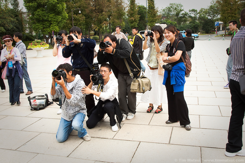 Chinese press photographers at Slender West Lake in Yangzhou, China, once a regional trading hub and now a suburb city of Shanghai and major producer of photovoltaic cells for solar power.