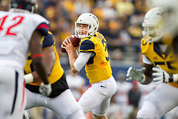 Sep 12, 2015; Morgantown, WV, USA; West Virginia Mountaineers quarterback Skyler Howard drops back for a pass against the Liberty Flames during the first quarter at Milan Puskar Stadium.  Mandatory Credit: Ben Queen-USA TODAY Sports