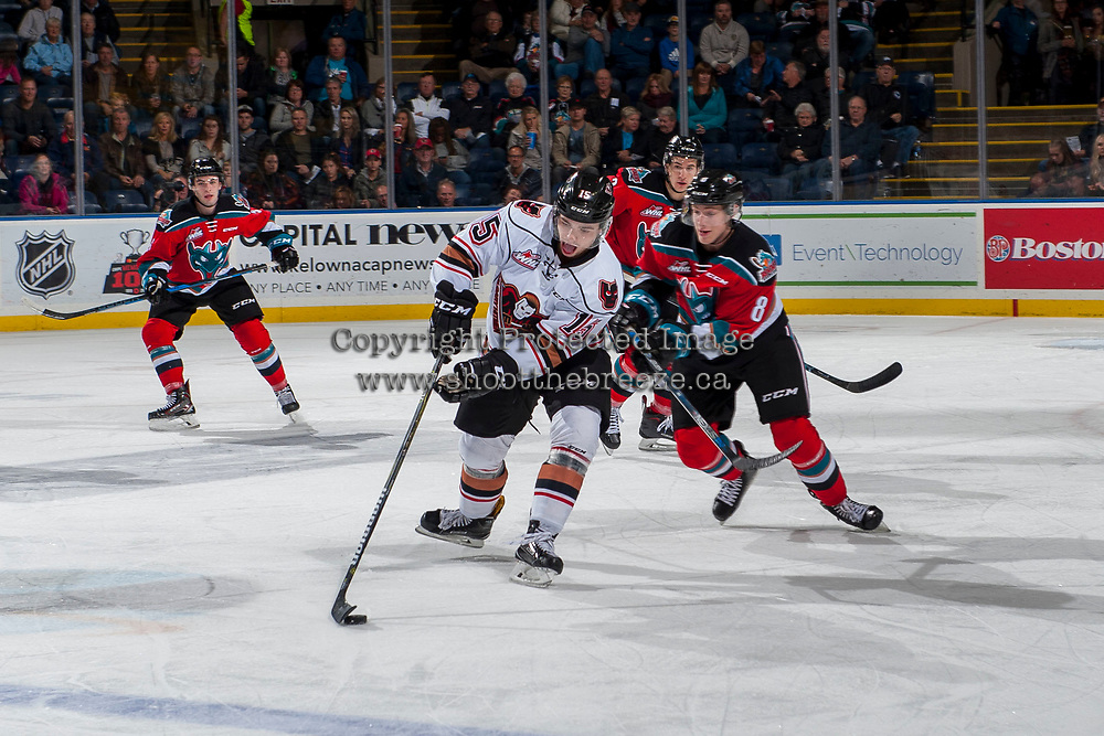 KELOWNA, CANADA - OCTOBER 13: Jack Cowell #8 of the Kelowna Rockets back checks Tristen Nielsen #15 of the Calgary Hitmen as he skates with the puck during first period on October 13, 2017 at Prospera Place in Kelowna, British Columbia, Canada.  (Photo by Marissa Baecker/Shoot the Breeze)  *** Local Caption ***