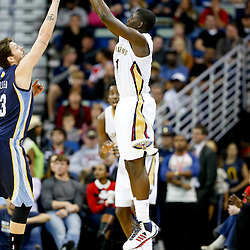 Dec 13, 2013; New Orleans, LA, USA; New Orleans Pelicans point guard Jrue Holiday (11) shoots a three point basket over Memphis Grizzlies small forward Mike Miller (13) during the fourth quarter of a game at New Orleans Arena. The Pelicans defeated the Grizzlies 104-98. Mandatory Credit: Derick E. Hingle-USA TODAY Sports