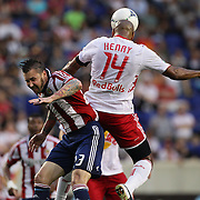 New York Red Bulls player Thierry Henry wins a header from Danny Califf, Chivas USA, during the New York Red Bulls V Chivas USA Major League Soccer match at Red Bull Arena, Harrison, New Jersey, 23rd May 2012. Photo Tim Clayton