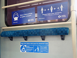 Social distancing signs on London underground train during Coronavirus lockdown, UK June 2020