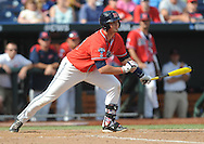 Mississippi's John Gatlin (36) hits a game winning single in the bottom of the 9th inning against Texas Tech at T.D. Ameritrade Park in the College World Series in Omaha, Neb. on Tuesday, June 17, 2014. Ole Miss won 2-1.