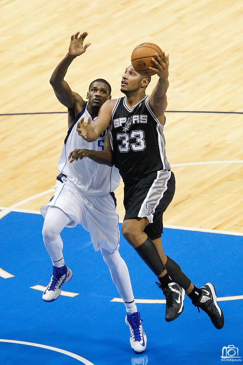San Antonio Spurs center Boris Diaw (33) takes the ball to the basket against Dallas Mavericks center Bernard James (5) at American Airlines Center in Dallas, Texas, on January 25, 2013.  The Spurs went on to beat the Mavericks 113-107.  (Stan Olszewski/The Dallas Morning News)