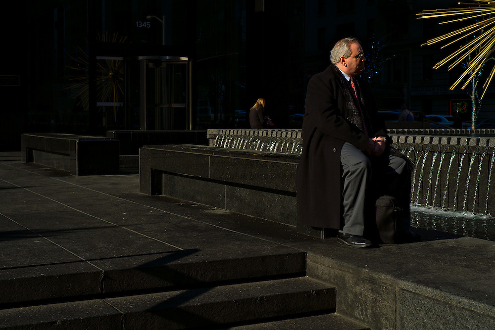 Man sitting by fountain