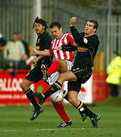 Photo. Chris Ratcliffe<br />Cheltenham v Hull. FA Cup Preliminary Round 08/10/2003<br />Ben Burgess of Hull and John Brough of Cheltenham collide