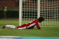 BELGRADE, SERBIA & MONTENEGRO - Wednesday, August 20, 2003: Wales' Simon Davies lies on the floor after missing a header against Serbia & Montenegro during the UEFA European Championship qualifying match at the Red Star Stadium. (Pic by David Rawcliffe/Propaganda)