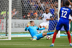 France's Samuel Umtiti (not pictured) scores his side's first goal of the game past England goalkeeper Tom Heaton