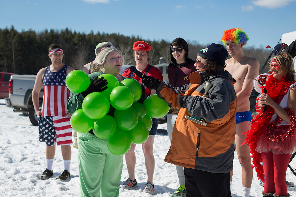 Cheri McCollum, of Albany, Ohio, talks about her grape nuts costume at the Polar Plunge on February 13, 2016. McCollum won the individual costume contest.