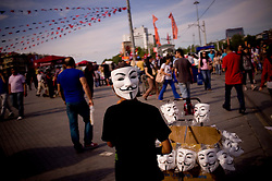 © London News Pictures. 06/06/2013 . Istanbul, Turkey.  A boy sells Anonymous masks in Taksim Square.  After several days of hard altercations Taksim Square in Istanbul has lived a quiet day with camping and claims against the government.. Photo credit: Jordi Boixareu/LNP