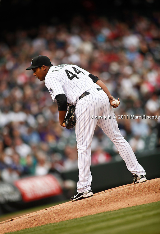 SHOT 5/28/11 5:17:20 PM - Colorado Rockies pitcher Juan Nicasio pitches against the St. Louis Cardinals during their regular season MLB game at Coors Field in Denver, Co. The Rockies won the game 15-4. It was Nicasio's first time pitching after being called up from double-A ball. (Photo by Marc Piscotty / © 2011)
