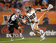 DENVER, CO - MAY 18: Drew Snider #23 of the Denver Outlaws plays defense against Kyle Denhoff #25 of the Rochester Rattlers during their game at Sports Authority Field at Mile High May 18, 2013 in Denver, Colorado. The Denver Outlaws won the game 20-7. (Photo by Marc Piscotty/Getty Images) *** Local Caption *** Drew Snider; Kyle Denhoff