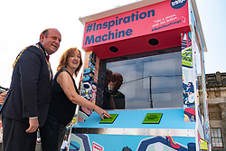 Edinburgh, Scotland, UK. 31 July 2019. Frank Ross, Lord Provost of Edinburgh  and Shona McCarthy, Chief Executive of of the Edinburgh Festival Fringe Society proclaimed the start of the 2019 Fringe by pushing the button on the new colourful arcade style Fringe Inspiration Machine on The Mound in Edinburgh today. The new Inspiration Machine is designed to help out audiences who might be having trouble deciding which shows to see from the diverse programme, by delivering three randomised suggestions of Fringe shows at the push of a button.