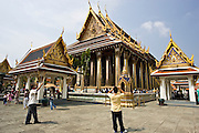 Tourists photograph the Royal Temple of the Emerald Buddha,Wat Phra Keow and Salarai, Bangkok, Thailand