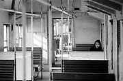 Lone lady on empty train, looking