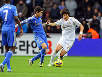 Saturday, 03 November 2012..Pictured: Ki Sung Yueng of Swansea (R) against Oscar of Chelsea (L)..Re: Barclays Premier League, Swansea City FC v Chelsea at the Liberty Stadium, south Wales.
