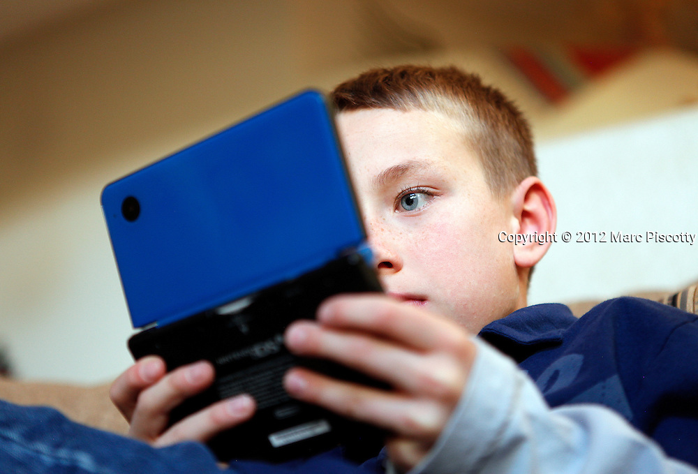 SHOT 12/25/11 4:35:38 PM - Jacob O'Connell, 9, of Albuquerque, N.M. plays a video game on a Nintendo DS during the holidays in Albuquerque, N.M. (Photo by Marc Piscotty /  © 2012)
