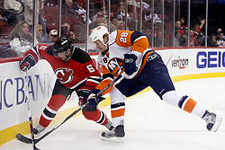 November 16, 2007; Newark, NJ, USA; New Jersey Devils defenseman Andy Greene (6) and New York Islanders right wing Tim Jackman (28) work for the loose puck during the first period at the Prudential Center in Newark, NJ.