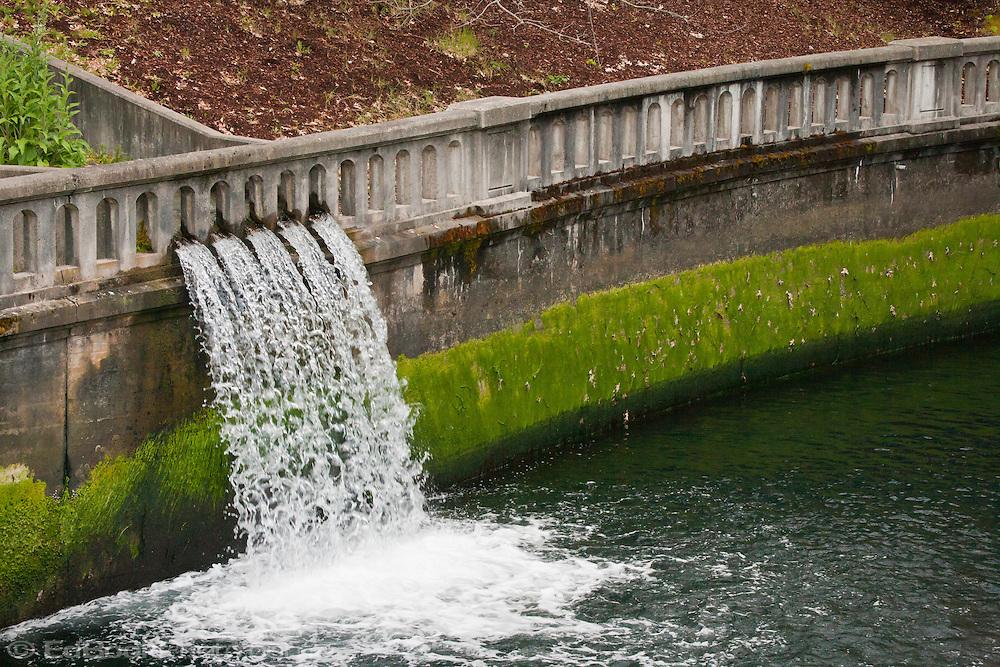 stopped motion waterfall through a wall railing at the Cushman Power Generator station at the Hood Canal Tacoma City Light Hoodsport, Washington, USA
