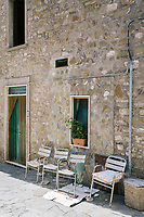 ACCIAROLI, ITALY - 14 SEPTEMBER 2018: Chairs used by elderly men and women are seen here in front of a house in Acciaroli, a small fishing village in the municipality of Pollica, Italy, on September 14th 2018.<br /> <br /> To understand how people can live longer throughout the world, researchers at University of California, San Diego School of Medicine have teamed up with colleagues at University of Rome La Sapienza to study a group of 300 citizens, all over 100 years old, living in Acciaroli (Pollica), a remote Italian village nestled between the ocean and mountains in Cilento, southern Italy.<br /> <br /> About 1-in-60 of the area's inhabitants are older than 90, according to the researchers. Such a concentration rivals that of other so-called blue zones, like Sardinia and Okinawa, which have unusually large percentages of very old people. In the 2010 census, about 1-in-163 Americans were 90 or older.