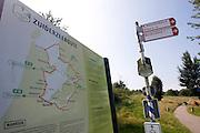 Een bord bij Huizen met de Zuiderzeeroute voor de fiets. De tocht is 400 km lang.<br /> <br /> Directions for cyclist to roud the IJsselmeer.