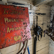 Old safety and firefighting equipment hangs on a wall near an exit at Wordie House. Originally known as Base F and later renamed after James Wordie, chief scientist on Ernest Shackleton's major Antarctic expedition, Wordie House dates to the mid-1940s. It was one of a handful of bases built by the British as part of a secret World War II mission codenamed Operation Tabarin. The house is preserved intact and stands near Vernadsky Research Base in the Argentine Islands in Antarctica.