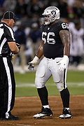 Oakland Raiders offensive guard Gabe Jackson (66) talks to an official during the 2018 regular season week 1 NFL football game against the Los Angeles Rams on Monday, Sept. 10, 2018 in Oakland, Calif. The Rams won the game 33-13. (©Paul Anthony Spinelli)