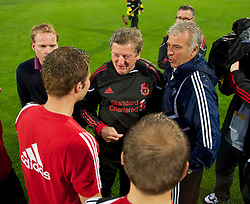 ALTACH, AUSTRIA - Saturday, July 17, 2010: Liverpool's manager Roy Hodgson and Al-Hilal Al Saudi FC coach Eric Gerets chats with the referee about the waterlogged pitch before the Reds' first preseason match of the 2010/2011 season at the Cashpoint Arena. (Pic by David Rawcliffe/Propaganda)