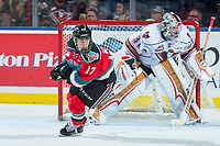 KELOWNA, CANADA - OCTOBER 13: Kyle Crosbie #17 of the Kelowna Rockets looks for the pass ahead of Nick Schneider #31 of the Calgary Hitmen during second period on October 13, 2017 at Prospera Place in Kelowna, British Columbia, Canada.  (Photo by Marissa Baecker/Shoot the Breeze)  *** Local Caption ***