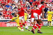 Wimbledon midfielder Tom Soares (19) tackles Barnsley midfielder Brad Potts (20)  during the EFL Sky Bet League 1 match between Barnsley and AFC Wimbledon at Oakwell, Barnsley, England on 18 August 2018.