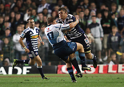 CAPE TOWN, SOUTH AFRICA - 11 JUNE 2011, Stormers eighthman Duane Vermuelen attempts to get through Rossouw de Klerk of the Bulls during the Super Rugby match between DHL Stormers and the Bulls held at DHL Newlands Stadium in Cape Town, South Africa..Photo by Shaun Roy / Sportzpics.net