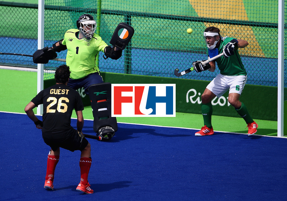 RIO DE JANEIRO, BRAZIL - AUGUST 11:  David Harte #1 and Ronan Gormley #6 of Ireland defend against a shot on goal as Matthew Guest #26 of Canada looks on during a Men's Preliminary Pool B match on Day 6 of the Rio 2016 Olympics at the Olympic Hockey Centre on August 11, 2016 in Rio de Janeiro, Brazil.  (Photo by Sean M. Haffey/Getty Images)