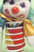 stuffed toy clown in coil